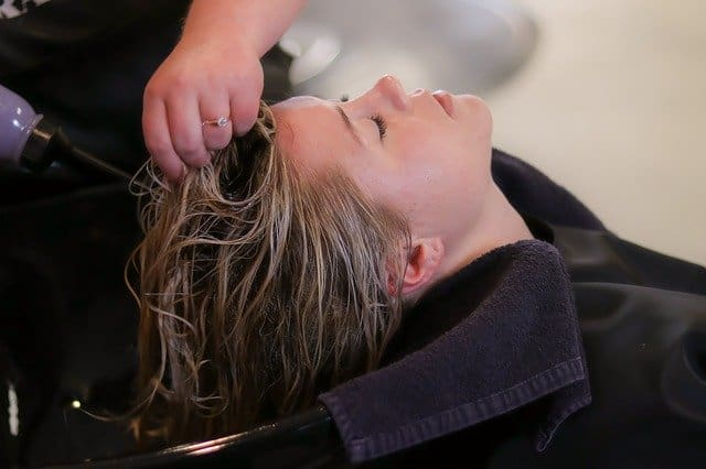 woman at the salon frugal living tips