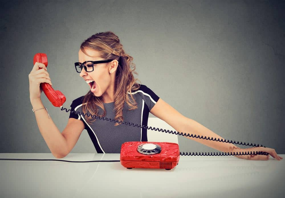 young woman yelling at phone work from home job