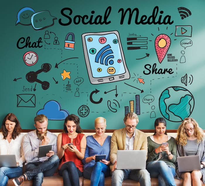group of people using social media to advertise