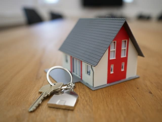small house and house key real estate agent
