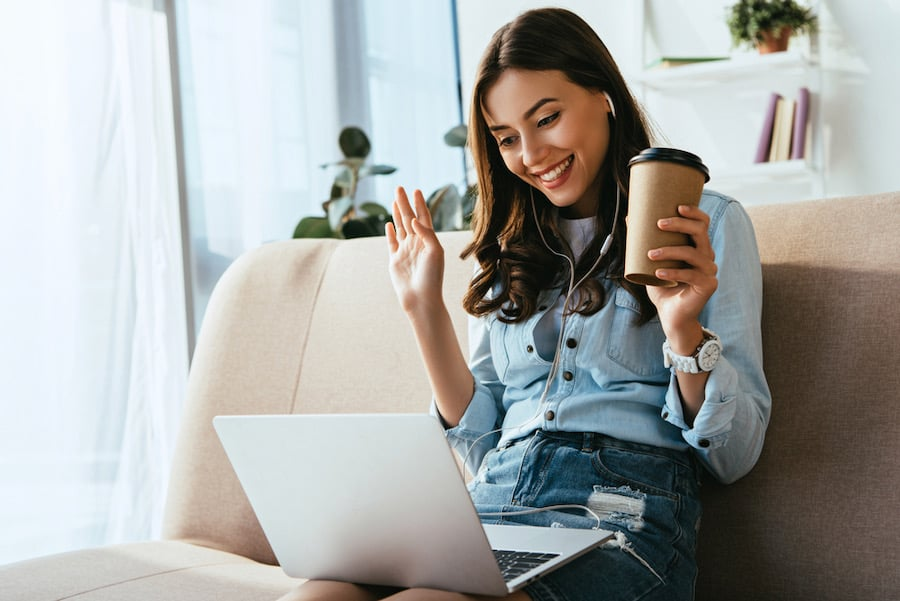 woman chatting to online friend on laptop