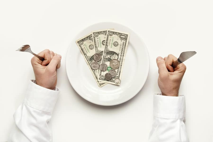 woman holding knife and fork with no money
