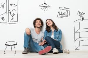 couple dreaming of new home living frugally on one income