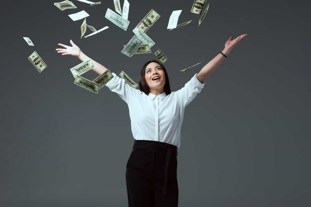 business woman with money falling down